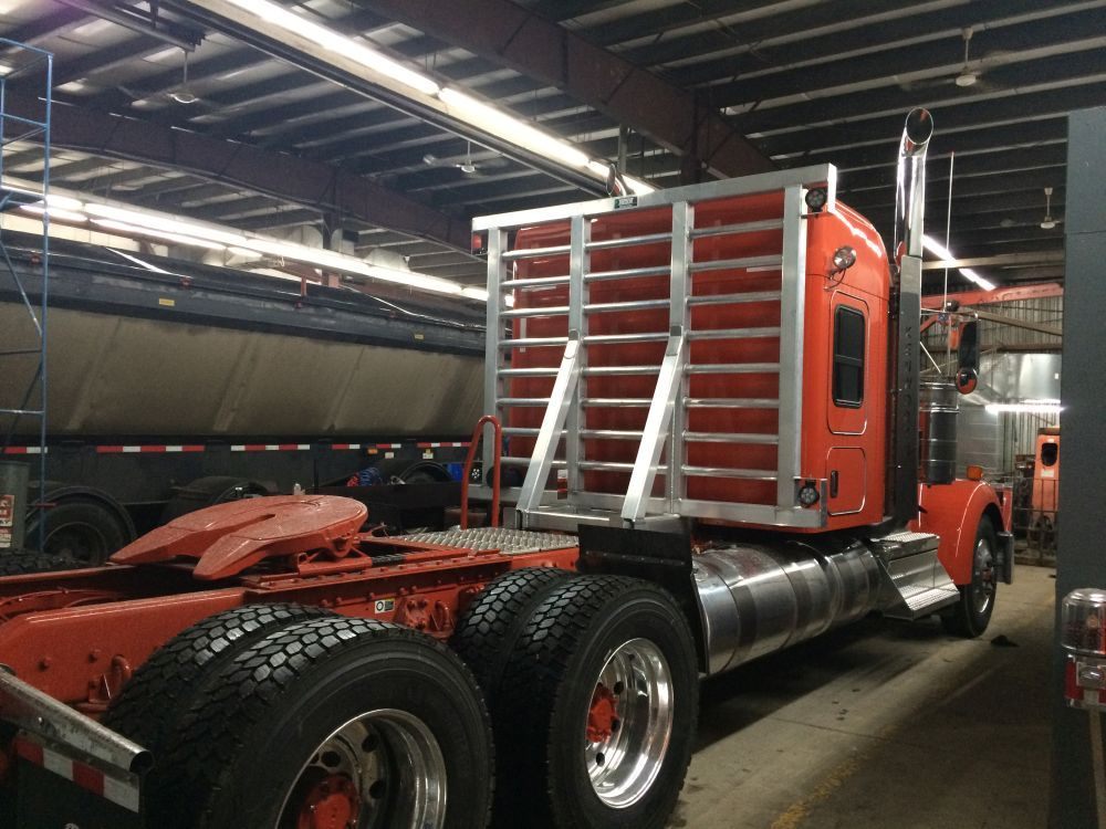Headache rack picture indoors orange tractor
