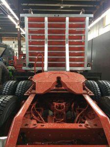 Headache rack rear view orange tractor
